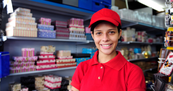 portrait of a salesgirl working  in  gift box store