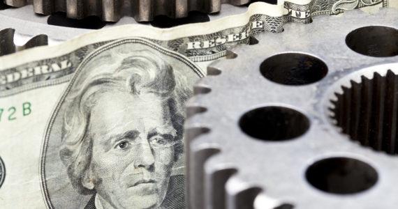 Money grinding in gears.