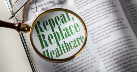 Magazine with article about Repeal Healthcare with magnifying glass. Concept. +all text written by photographer and is copyright free+